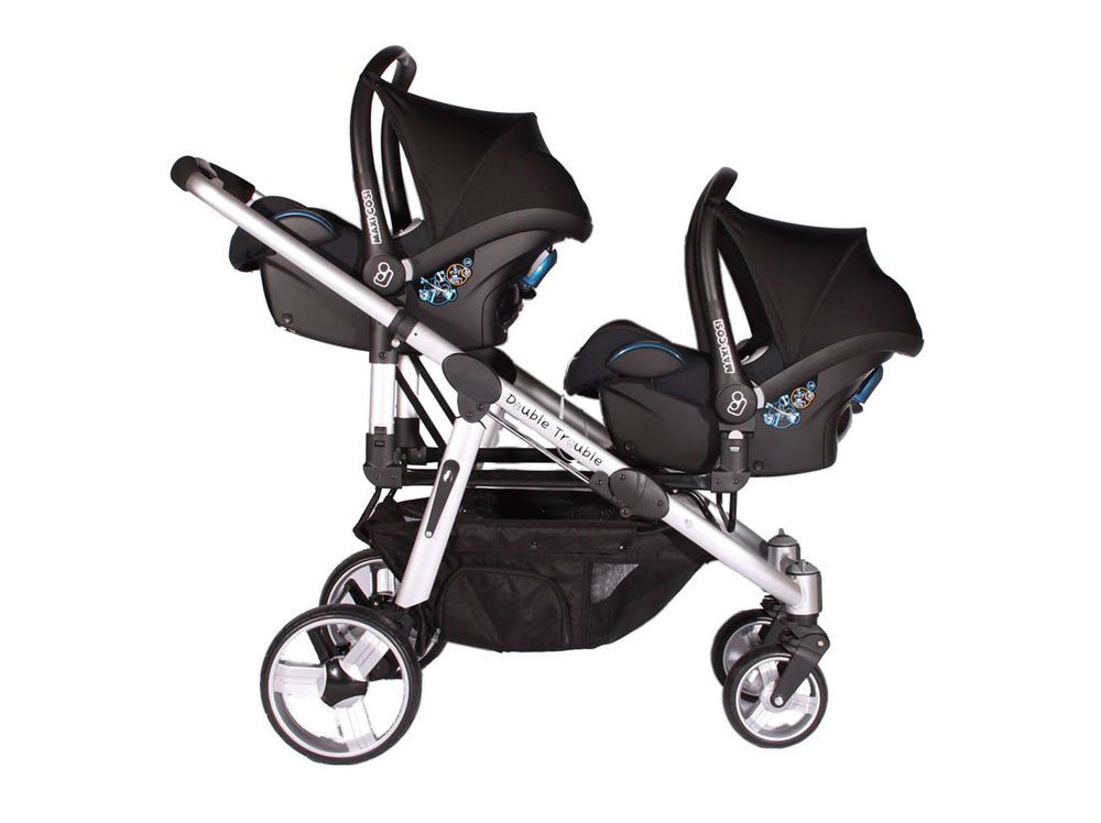 Twin pram with two baby car seats installed